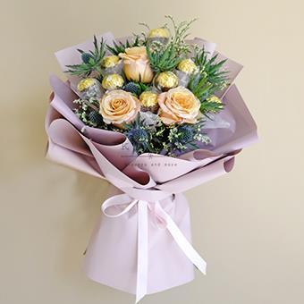 Irenic Charm ( Roses with Ferrero Rocher Chocolates)
