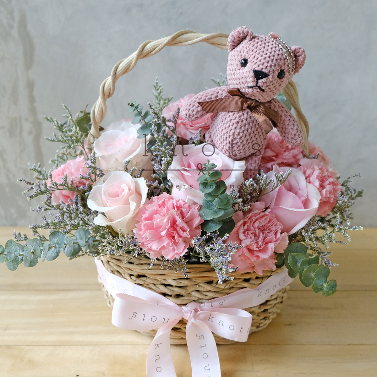 Pink roses and carnation in basket for mother